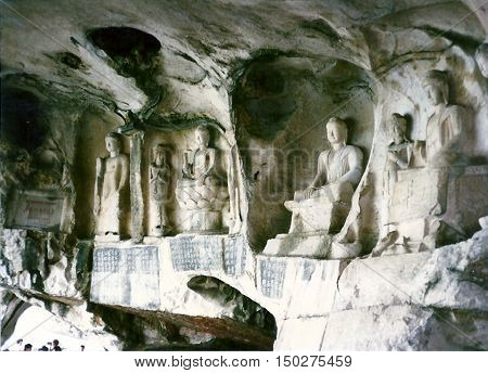 Ancient Tang Dynasty Buddhist sculptures carved in the wall of the Thousand Buddha Cave in Guilin, China, circa 1987.