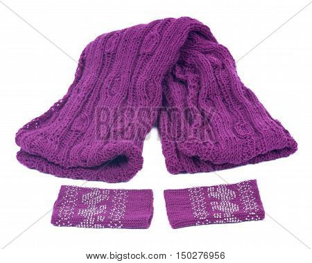 Violet knit wool scarf and wrists arm warmers separated on white background