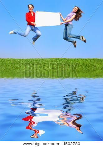 Girls Jumping With Blank Sheet