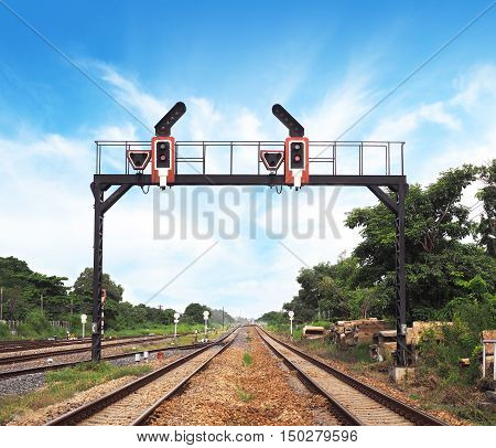Traffic light signal over railway track in Thailand