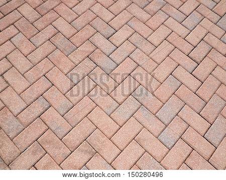 a herrigbone pattern created by bricks or pavers