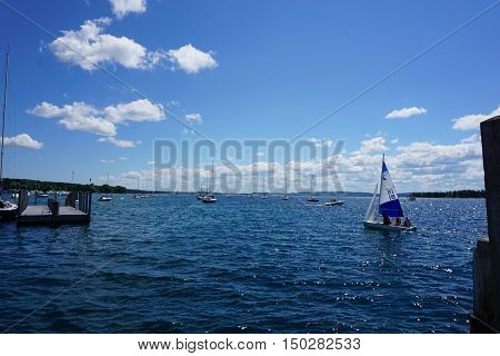 HARBOR SPRINGS, MICHIGAN / UNITED STATES - AUGUST 1, 2016: People enjoy a sailing lesson, provided by Little Traverse Sailors, near the Harbor Springs Yacht Basin.