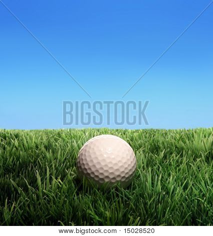 Golf ball on a plastic grass
