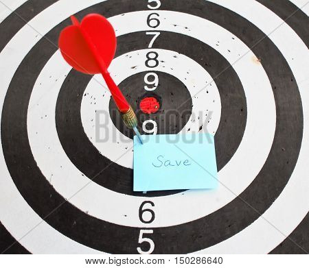 Note write save on red dart arrow hitting in the target center . concept idea.