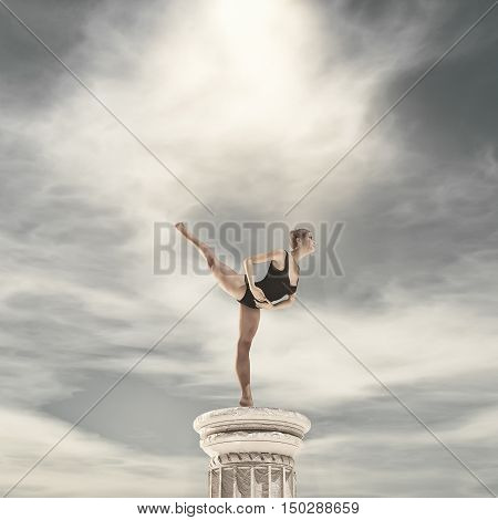 Ballerina standing on tiptoe above a column. This is a 3d render illustration
