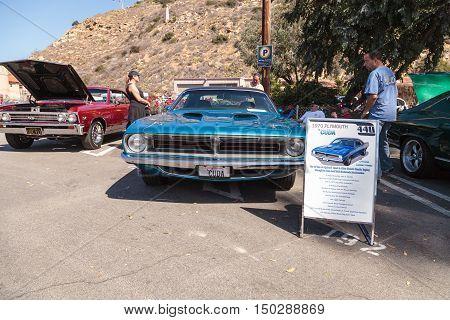 Laguna Beach, CA, USA - October 2, 2016: Blue 1970 Plymouth Cuda displayed at the Rotary Club of Laguna Beach 2016 Classic Car Show. Editorial use.