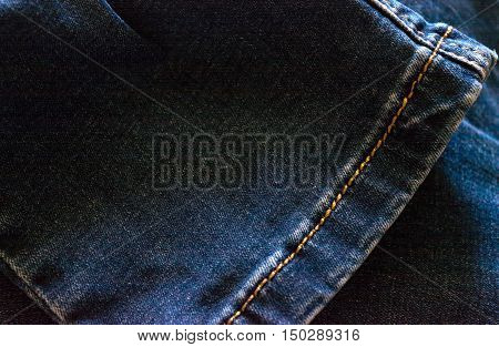 Trouser legs worn jeans. The rectangular background. Close-up.