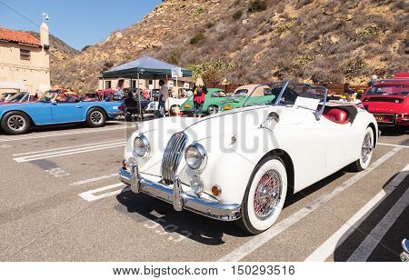 Laguna Beach, CA, USA - October 2, 2016: White 1956 Jaguar XK 140 MC formerly owned by Alex Trebek and now owned Robert Huntington and displayed at the Rotary Club of Laguna Beach 2016 Classic Car Show. Editorial use.
