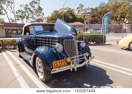 Laguna Beach, CA, USA - October 2, 2016: Navy blue 1936 Ford Roadster owned by Jim Sprinkel and displayed at the Rotary Club of Laguna Beach 2016 Classic Car Show. Editorial use.