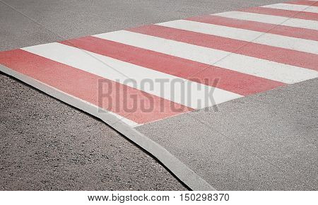 Pedestrian crossing with red and white marking