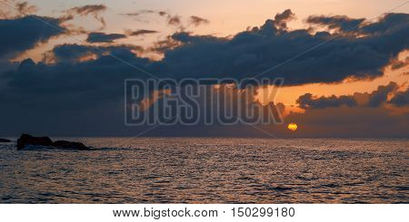 Sunset panoramic view of the sea and the horizon in Tobago Caribbean