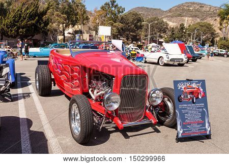 Laguna Beach, CA, USA - October 2, 2016: Red 1932 Ford Roadster Hi-Boy owned by Bob Whaler and displayed at the Rotary Club of Laguna Beach 2016 Classic Car Show. Editorial use.