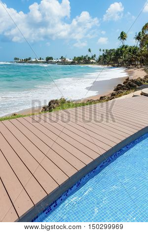 Tropical beach Tobago Caribbean nearby pool and wooden deck