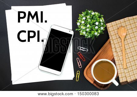 Text PMI (Managers Index), CPI (Consumer Price Index) on white paper / business concept
