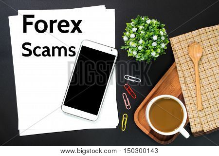 Text Forex Scams on white paper / business concept