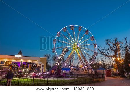 Gomel Belarus - April 17 2016: Amusement park in the blue hour with a beautiful night illumination