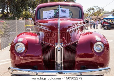 Laguna Beach, CA, USA - October 2, 2016: Red 1940 Ford Coupe owned by Donnie Crevier and displayed at the Rotary Club of Laguna Beach 2016 Classic Car Show. Editorial use.