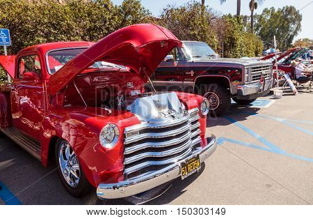 Laguna Beach, CA, USA - October 2, 2016: Red 1951 GM 1500 owned by Ed Rice and displayed at the Rotary Club of Laguna Beach 2016 Classic Car Show. Editorial use.