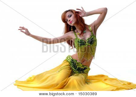 beautiful girl dances east dance isolated on a white