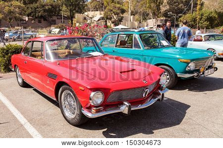 Laguna Beach, CA, USA - October 2, 2016: Red classic 1964 Rivolta GT Coupe owned by Ted Hirth and displayed at the Rotary Club of Laguna Beach 2016 Classic Car Show. Editorial use.