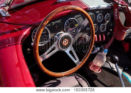 Laguna Beach, CA, USA - October 2, 2016: Red and white 1965 Shelby Cobra owned by Kim Connole and displayed at the Rotary Club of Laguna Beach 2016 Classic Car Show. Editorial use.