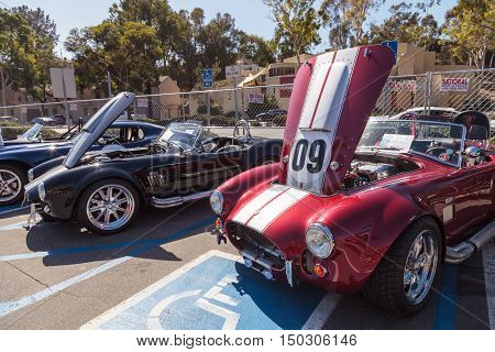 Laguna Beach, CA, USA - October 2, 2016: Red, black and blue Shelby Cobra line displayed at the Rotary Club of Laguna Beach 2016 Classic Car Show. Editorial use.
