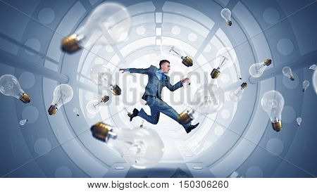 Jumping businessman in virtual room . Mixed media