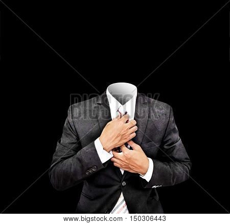 Headless businessman in old antique black suit, isolated on black background