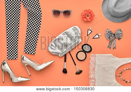 Fashion Design Outfit. Essentials fashion Cosmetic Makeup. Fashion woman Clothes Accessories Set. Stylish Leggings, Glamor fashion Heels, Handbag Clutch, Trendy Sunglasses. Top view. Creative. Minimal