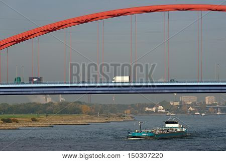 DUISBURG GERMANY - October 26: Barge on the river Rhine on October 26 2015 in Duisburg Germany. Duisburg is the largest river port in Europe (Duisport)