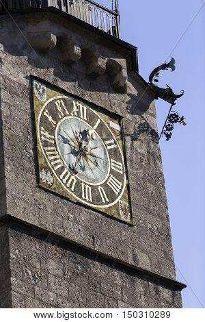 Clock of the Stadtturm a landmark watchtower built in the 1400s in Innsbruck Austria
