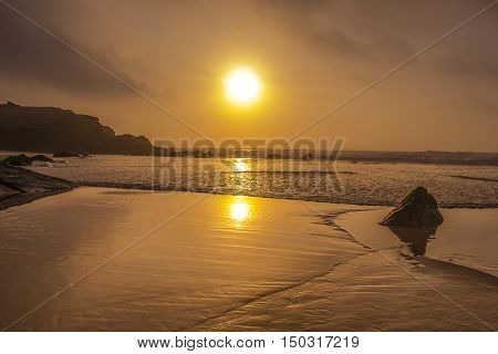 beautifull beach and sunset reflection on the water
