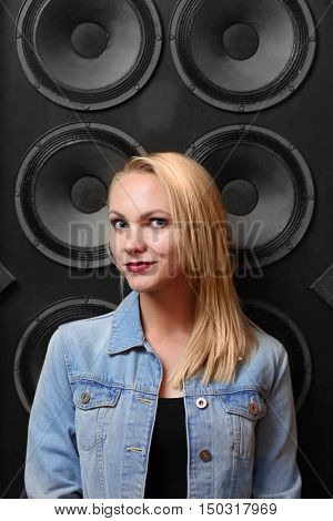 Young woman on audio system background