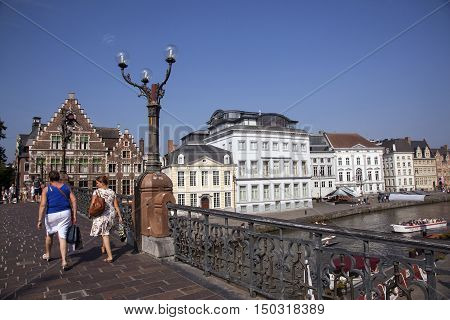 Ghent, Belgium, 27 august 2016: women walk on st michielsbrug in centre of medieval Ghent in Belgium on sunny summer day
