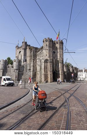 Ghent, Belgium, 27 august 2016: woman and baby in front of castle Gravensteen  on sunny summer day in Flemish town of Ghent in Belgium