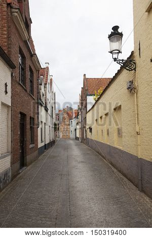 old empty cobblestone street in the belgian city of bruges