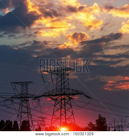 The evening electricity pylon silhouette it is very beautiful
