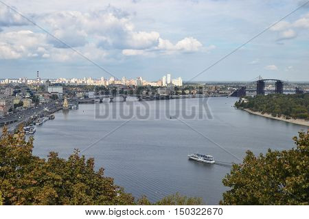 View of the city Kiev and the Dnieper River with a new bridge. Capital of Ukraine - Kyiv.