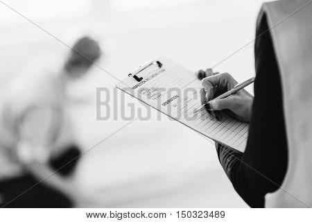 Maintenance Engineer Checking Air Conditioner