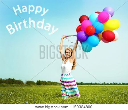 Happy Birthday text and woman with colorful balloons in field on blue sky background