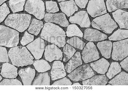 abstract texture of a facing stone of gray color for a background or for wallpaper