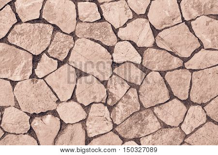 abstract texture of a facing stone of brown color for a background or for wallpaper