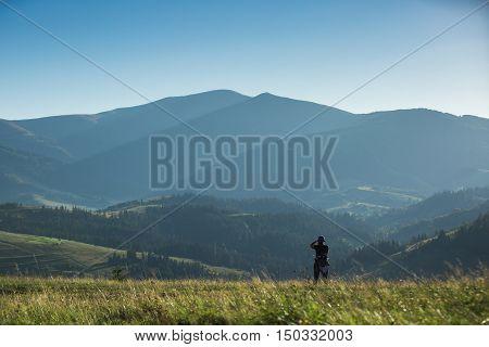 Photographer Shoots A Mountain Landscape