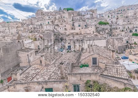 Typical House Of Stones (sassi Di Matera)  Of Matera Under Blue Sky. Matera In Italy