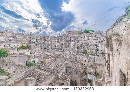 Typical View Of Stones (sassi Di Matera)  Of Matera Under Blue Sky. Matera In Italy