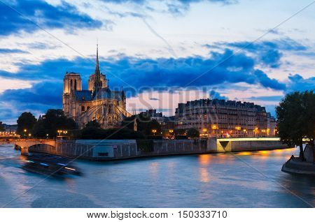Notre Dame cathedral church and Cite island at sunset, Paris, France, toned