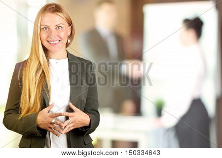 he Beautiful smiling business woman portrait. Business people working in the office
