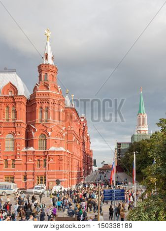 Moscow - September 10 2016: The people came to the celebration at Manezh Square and see the Kremlin and Lenin's mausoleum passage on Red Square September 10 2016 Moscow Russia