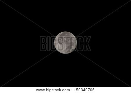 Full moon on the dark night. Full moon over dark black sky at night.