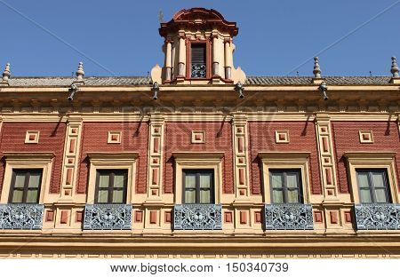 Palace with baroque windows in Sevilla, Spain